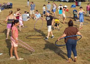 Image of a bunch of people playing with hoops